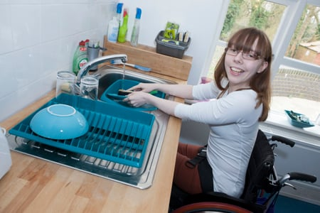Student washing up in her flat