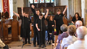 Students from the Orpheus Performance Group singing at All Saints Church, Lindfield