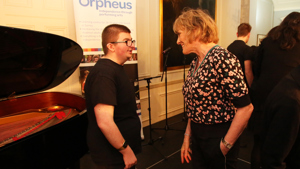 Student interacting with a guest at an Orpheus event
