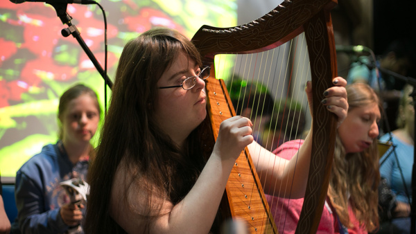 Student playing harp