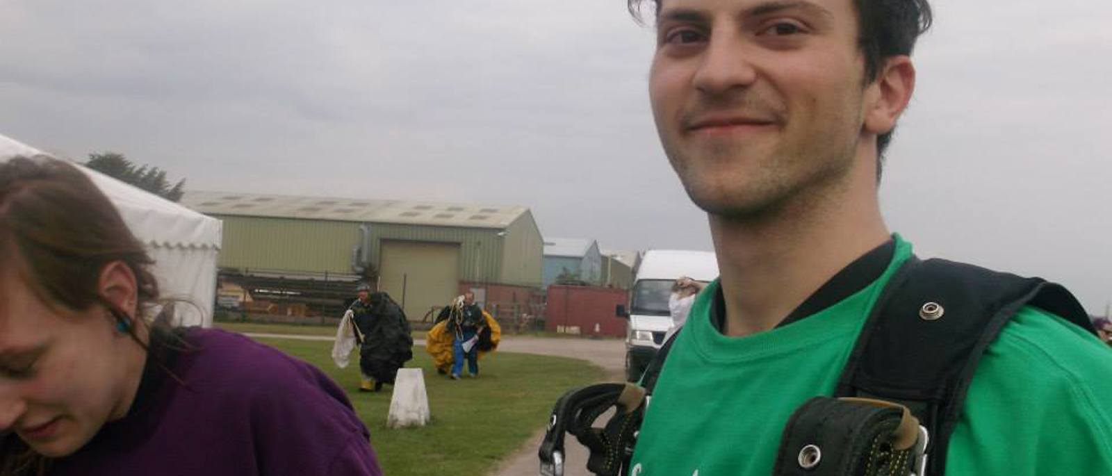Volunteer Laurence strapped into his parachute before he takes to the air.