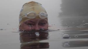 Photo of Helen swimming in cold water