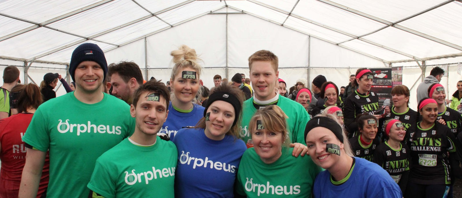 A group of Orpheus supporters taking part in a challenge event mud run